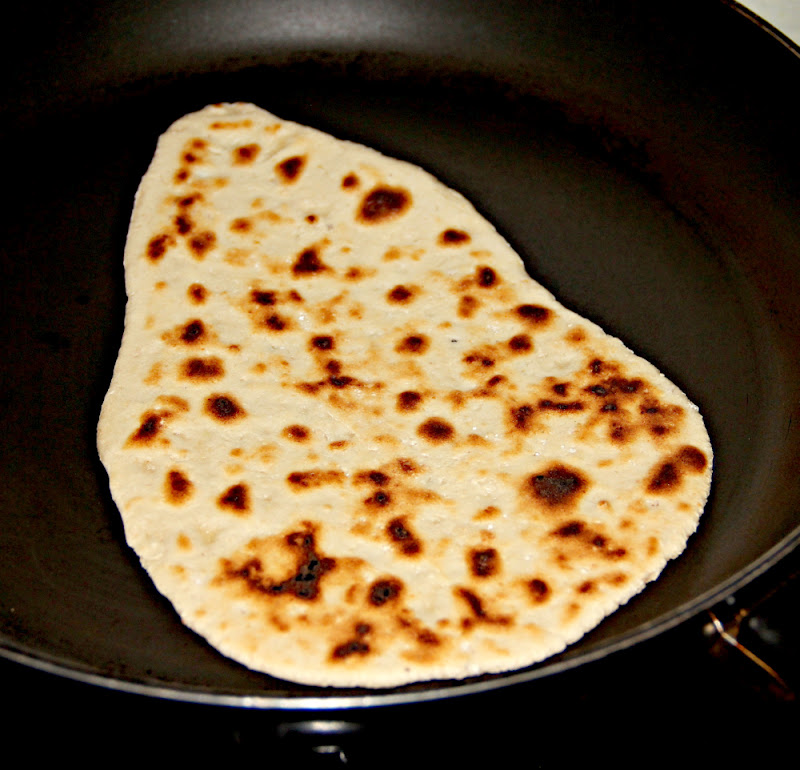 Now increase the flame so that the naan has nice brownish marks ...