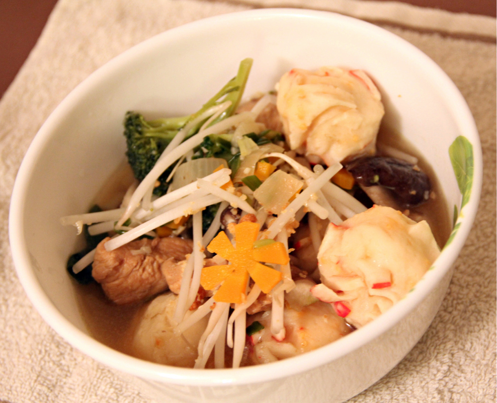 Asian fishball soup with flat rice noodles pic 1