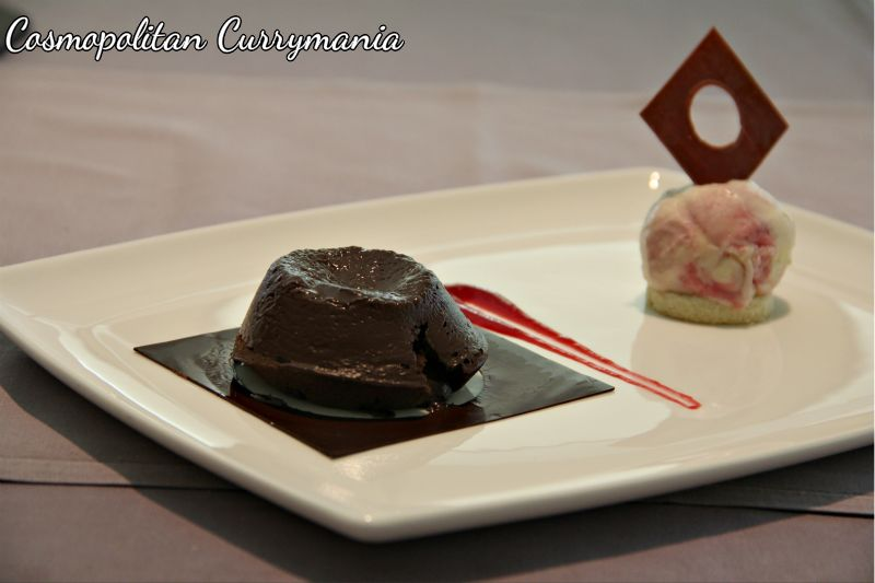 Baked chocolate and berry fondant with wild berry ice cream.