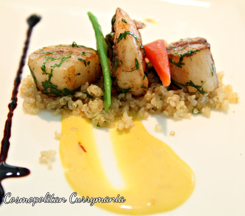 Grilled prawns and scallops with saffron fonduta and spicy quinoa