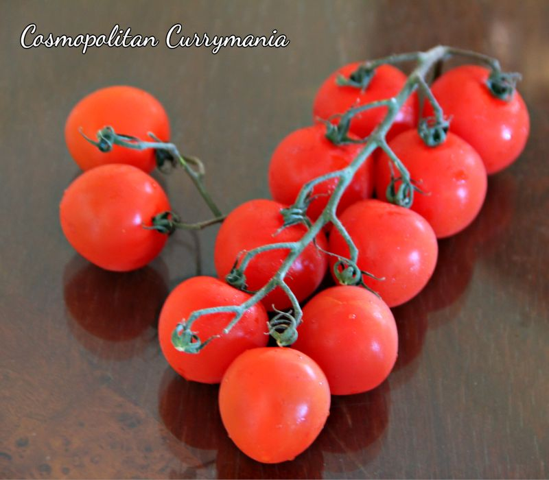 Cherry tomatoes on vine.