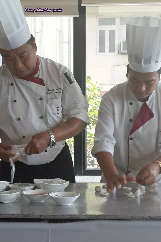 Chef Huang Tesing (left) with his Sous Chef, demonstrating how to make perfect dimsums.
