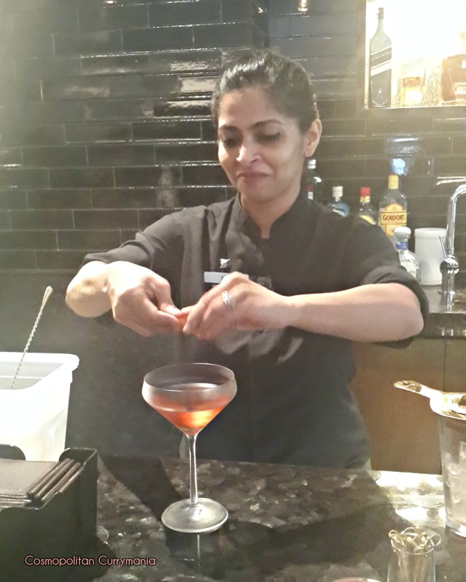Ema making a Ballantines whiskey cocktail