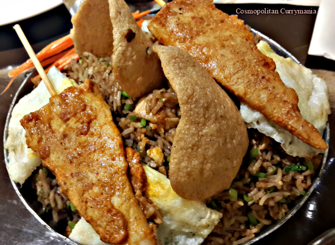 Nasi Goreng with shrimp crackers and chicken skewers. Served with a fried egg!
