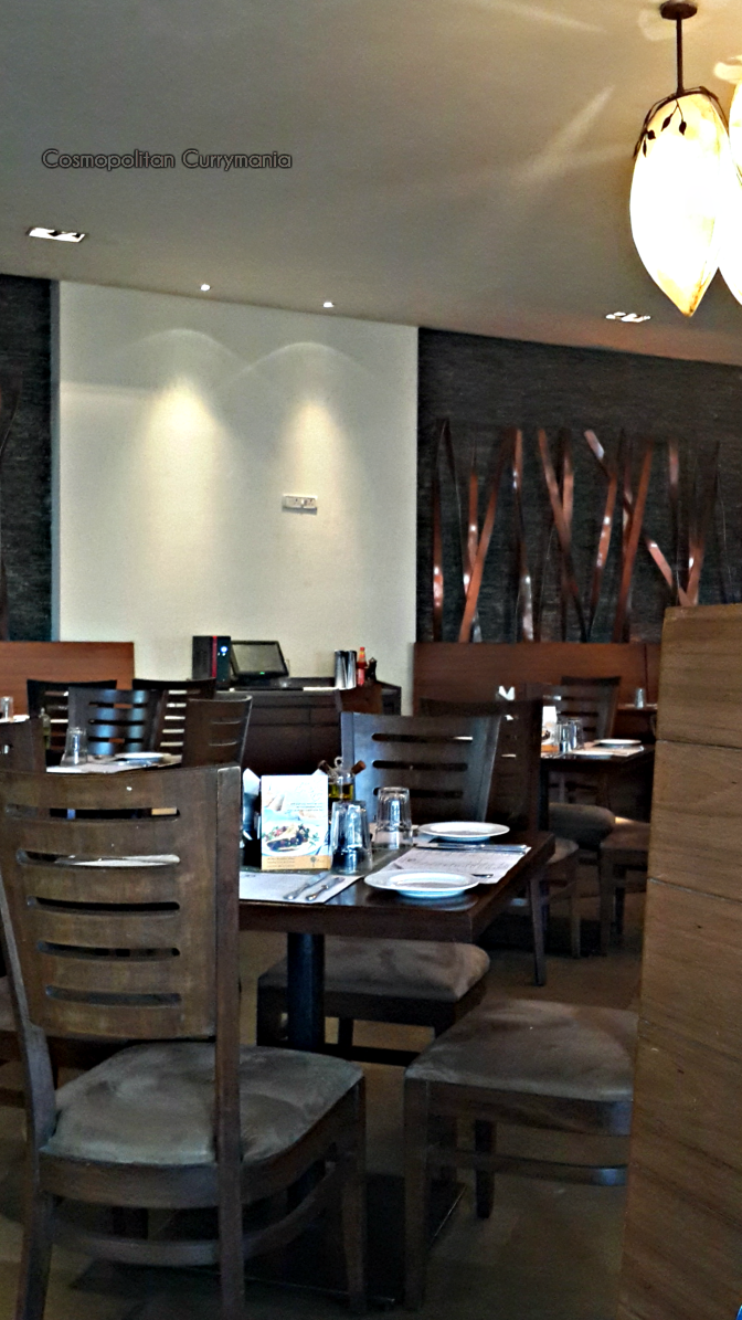 Ambience at Cafe Mangii, Powai: simple decor and comfortable seating.