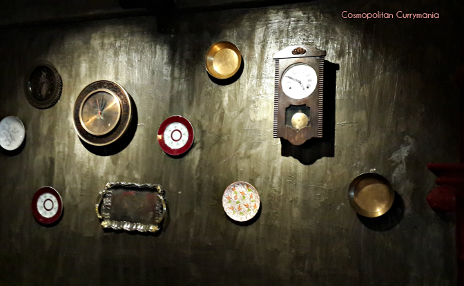 The walls are adorned with beautiful vintage clocks and plates in Bombay Vintage