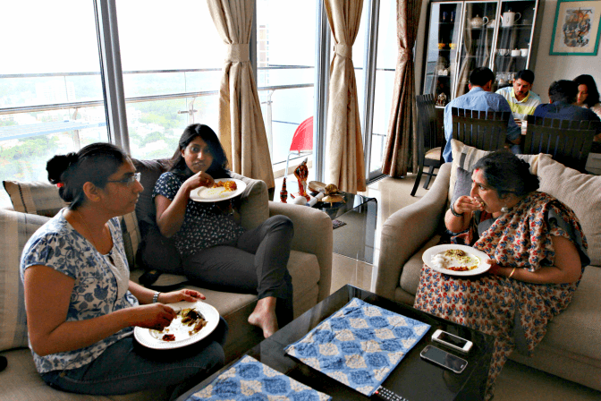 Guests eating Bengali food in Purabi Naha's Bengali home popup in Mumbai